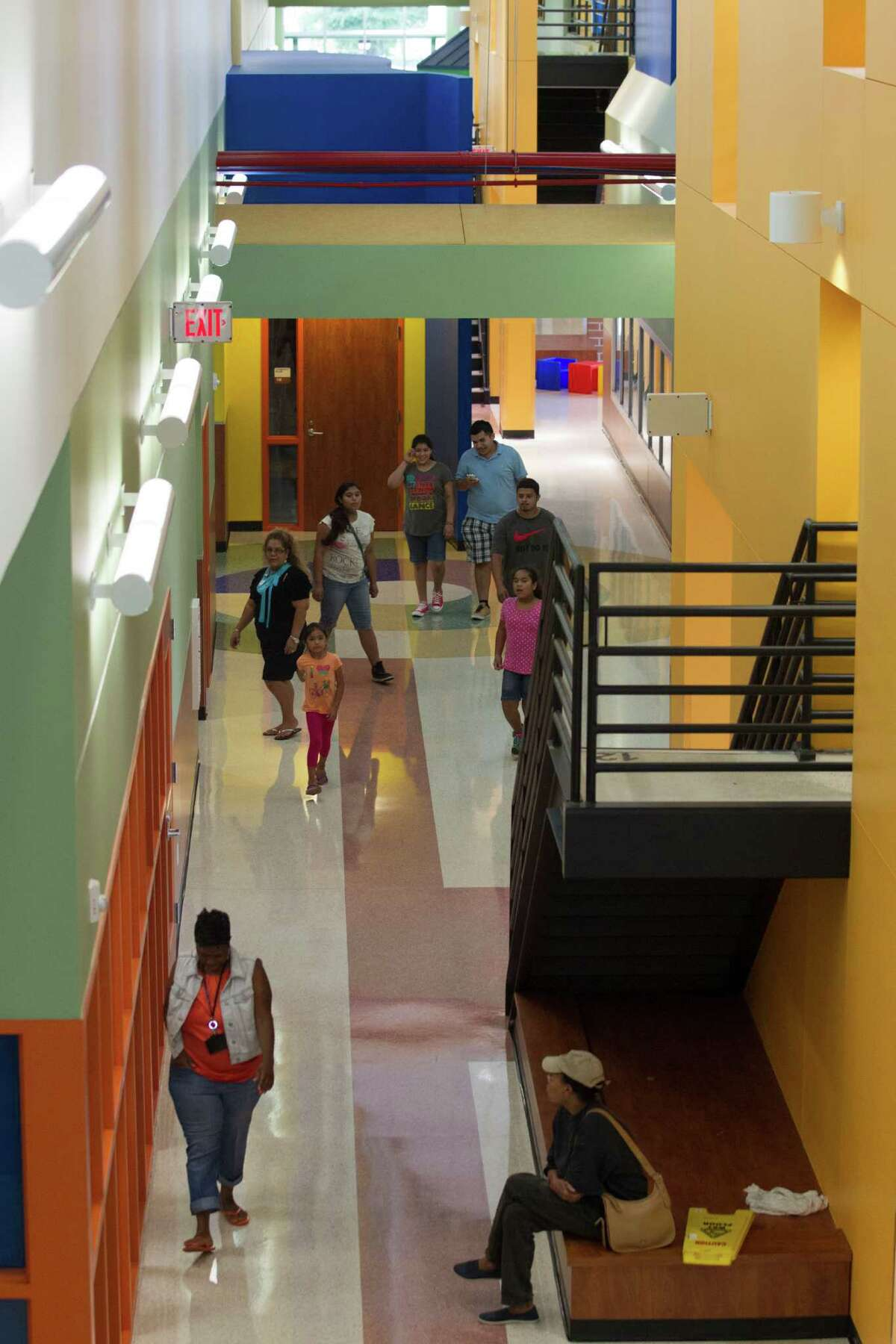 Parents and students walk through the hallways of Atherton Elementary School on Wednesday, Aug. 21, 2013, in Houston.