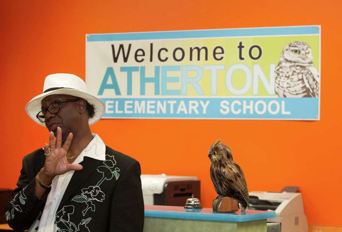 Atherton Elementary School principle Dr. Albert Lemons gives a tour of the new school on Wednesday, Aug. 21, 2013, in Houston.