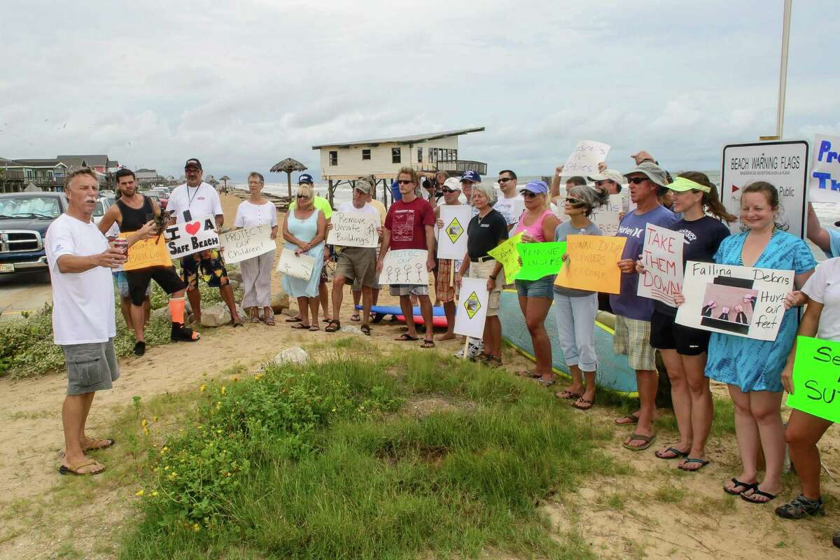 Chairman of the Surfrider Foundation, Ellis Pickett, left spoke at a rally to call attention to two abandoned beach houses on Surfside Beach plus call for their removal of the two homes, 08/25/13.