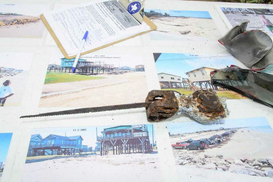 On the table some images of homes on Surfside Beach plus items that were found in the water in front of the two abandon homes.   A rally was held by the Surfrider Foundation to call attention to two abandoned beach houses on Surfside Beach plus call for their removal of the two homes. Photo: ©Kim Christensen / ©Kim Christensen