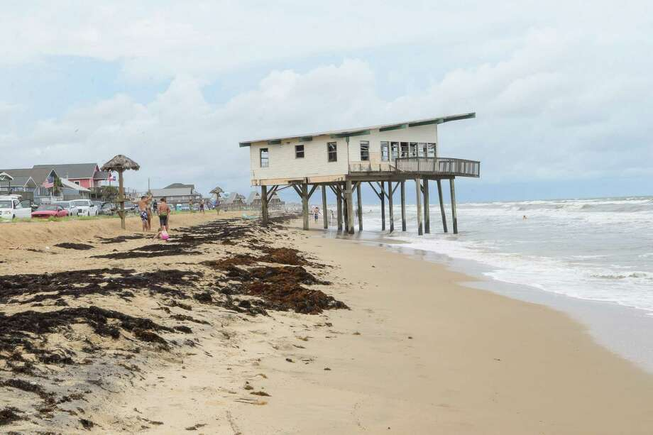 One of the two abandon homes sits along the the water line on Surside Beach.  A rally was held by the Surfrinder Foundation to call attention to two abandoned beach houses on Surfside Beach plus call for their removal. Photo: ©Kim Christensen / ©Kim Christensen