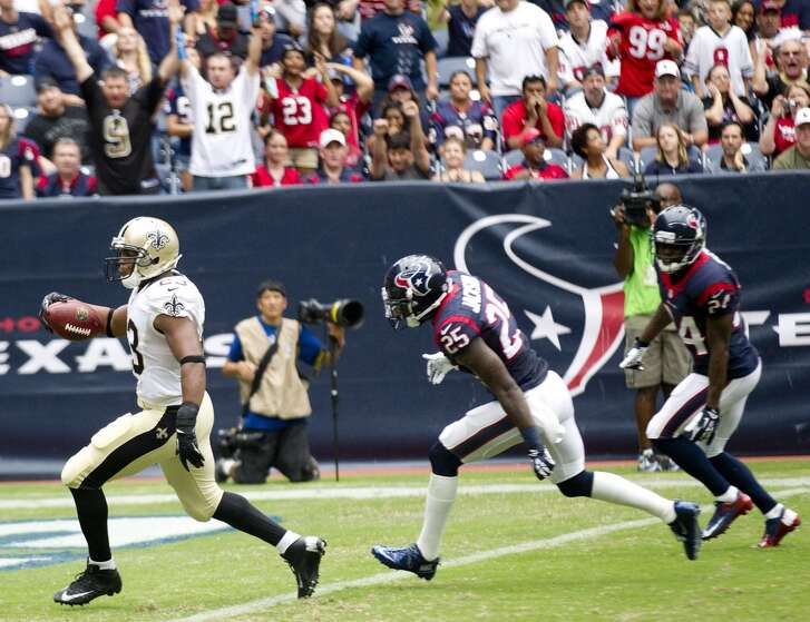 New Orleans Saints running back Pierre Thomas (23) outruns Houston Texans cornerbacks Kareem Jackson (25) and Johnathan Joseph (24) to the goal line on a 51-yard touchdown reception during the second quarter at Reliant Stadium on Sunday, Aug. 25, 2013, in Houston. ( Brett Coomer / Houston Chronicle )