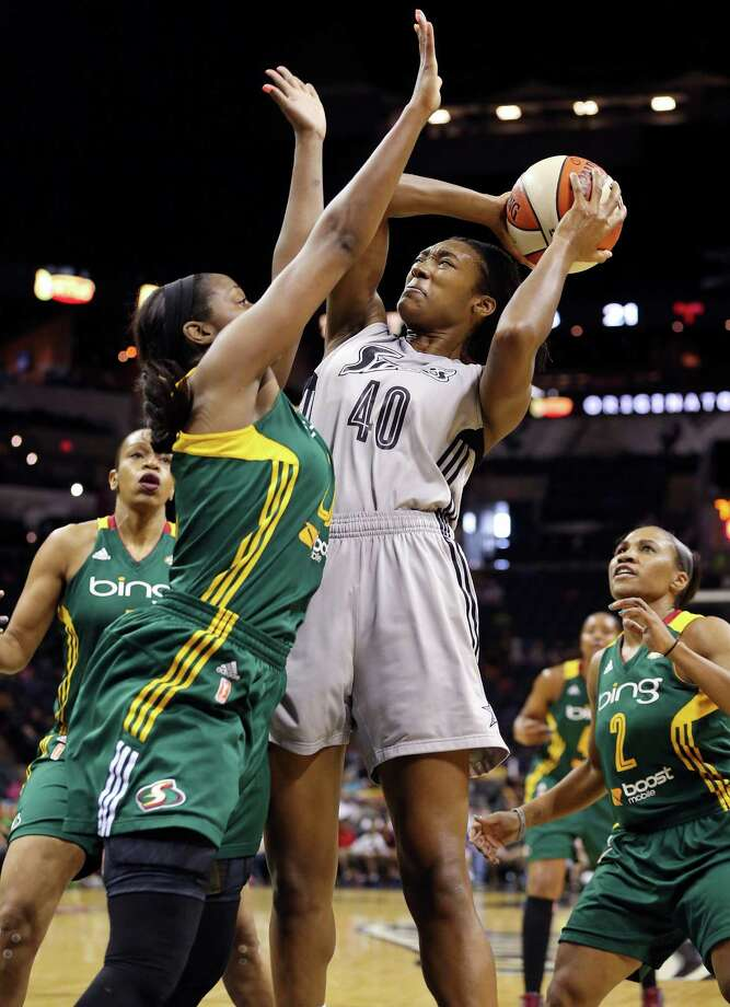 Silver Stars' Kayla Alexander drives to the basket against Seattle Storm's Camille Little during first half action Sunday Aug. 25, 2013 at the AT&T Center. Photo: Edward A. Ornelas, San Antonio Express-News / © 2012 San Antonio Express-News
