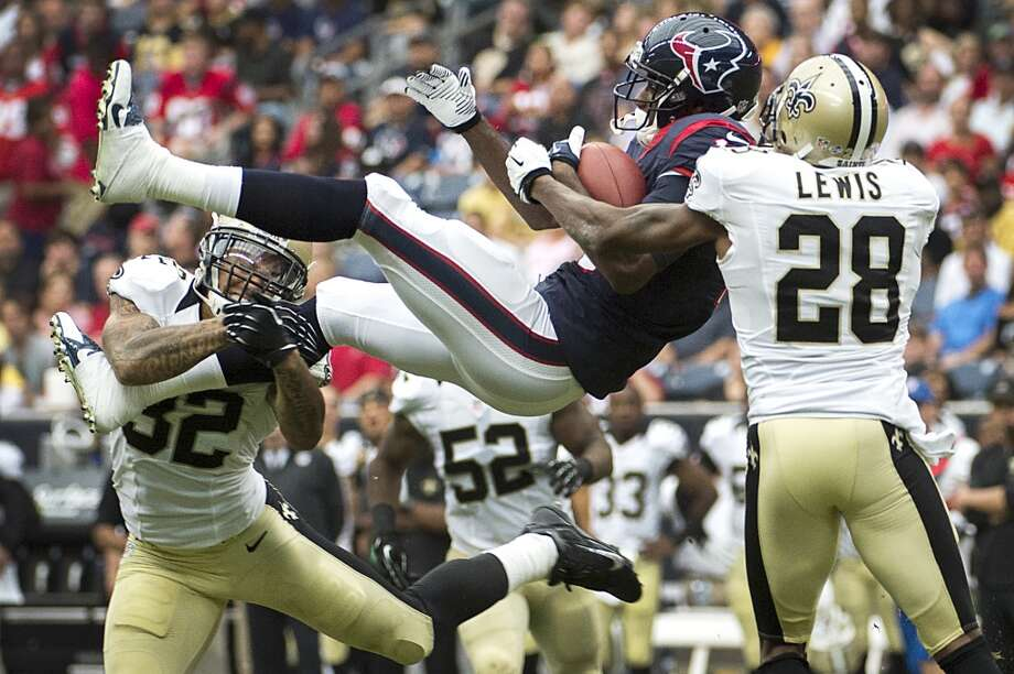 Saints 31, Texans 23  Texans wide receiver Lestar Jean is upended by Saints strong safety Kenny Vaccaro (32) and cornerback Keenan Lewis (28) as he makes a catch during the second half. Photo: Smiley N. Pool, Houston Chronicle