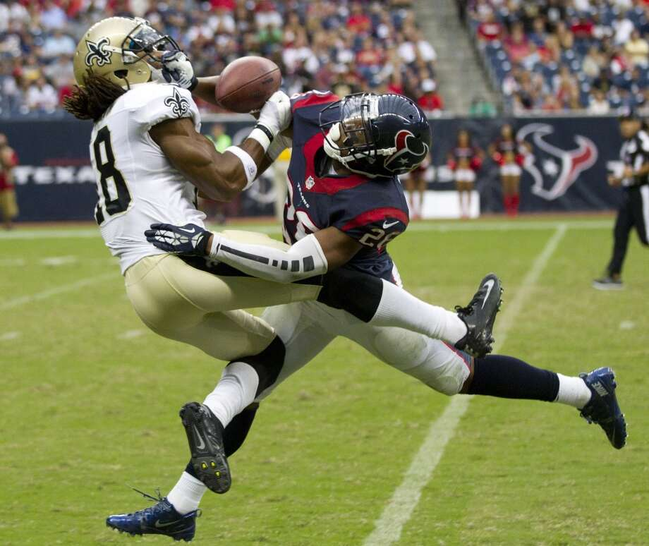 Texans defensive back Brandon Harris breaks up a pass intended for Saints wide receiver Saalim Hakim. Photo: Brett Coomer, Houston Chronicle