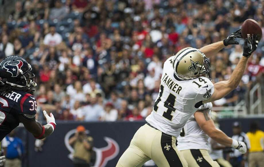 Saints wide receiver Andy Tanner hauls in a 15-yard touchdown reception past Texans safety D.J. Swearinger during the fourth quarter. Photo: Smiley N. Pool, Houston Chronicle