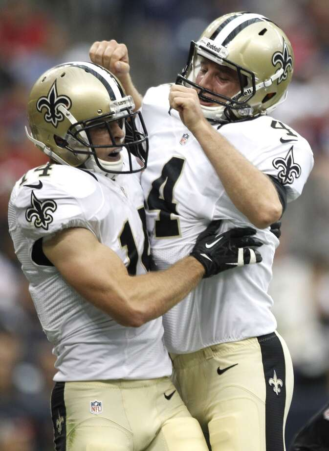 New Orleans Saints wide receiver Andy Tanner (14) and quarterback Ryan Griffin (4) celebrate Tanner's 15-yard touchdown reception. Photo: Brett Coomer, Houston Chronicle