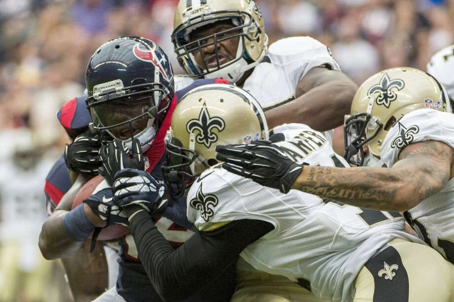 Texans running back Ben Tate is wrapped up by the Saints defense. Photo: Smiley N. Pool, Houston Chronicle