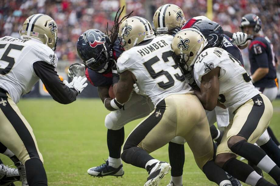 Texans running back Deji Karim is stuffed at the goal line by Saints linebacker Ramon Humber (53) on a fourth-and-goal try during the second half. Photo: Smiley N. Pool, Houston Chronicle