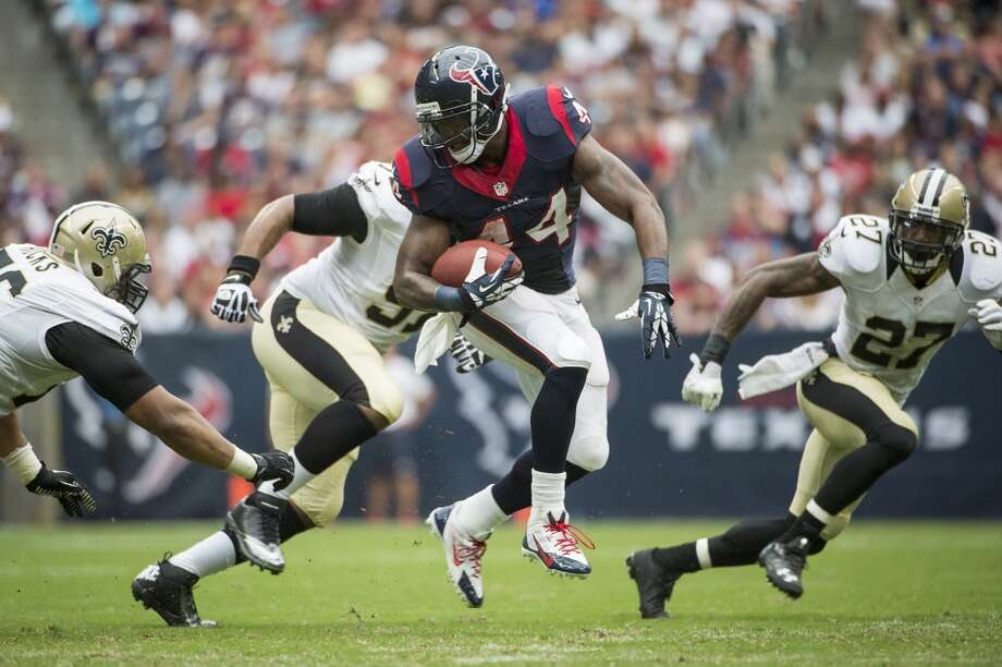 Texans running back Ben Tate spins through the Saints defense. Photo: Smiley N. Pool, Houston Chronicle