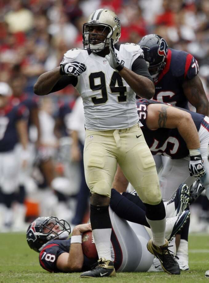 Saints defensive end Cameron Jordan (94) celebrates after sacking Texans quarterback Matt Schaub. Photo: Brett Coomer, Houston Chronicle
