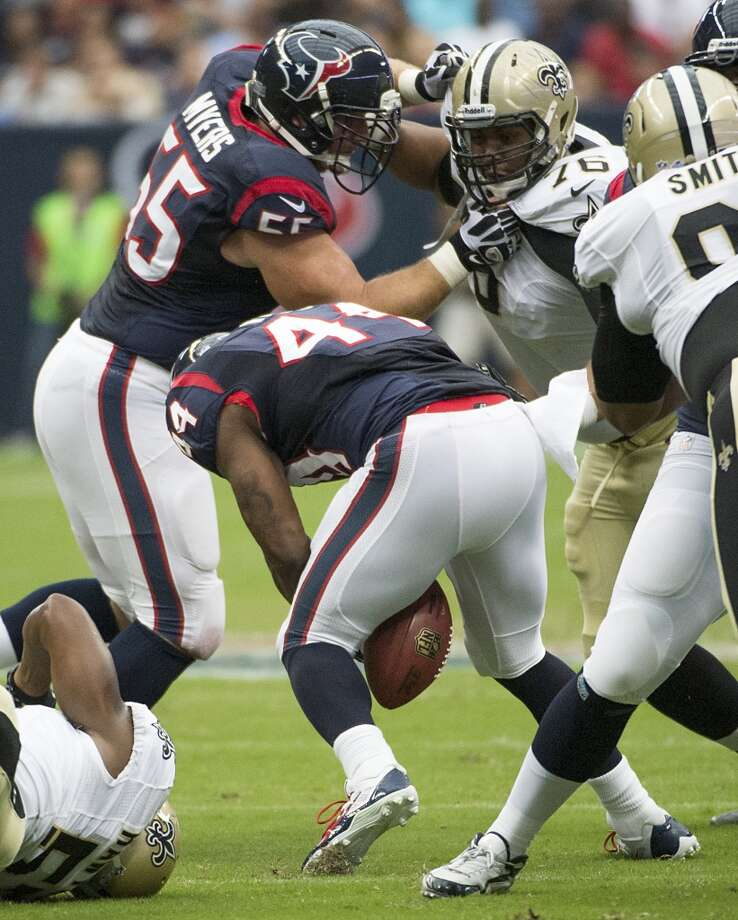 Texans running back Ben Tate ecovers his own fumble during the first half. Photo: Smiley N. Pool, Houston Chronicle