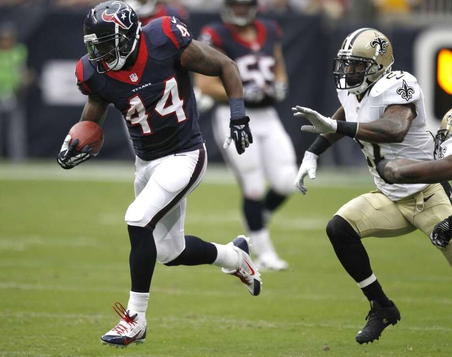 Texans running back Ben Tate breaks away from Saints free safety Malcolm Jenkins. Photo: Brett Coomer, Houston Chronicle