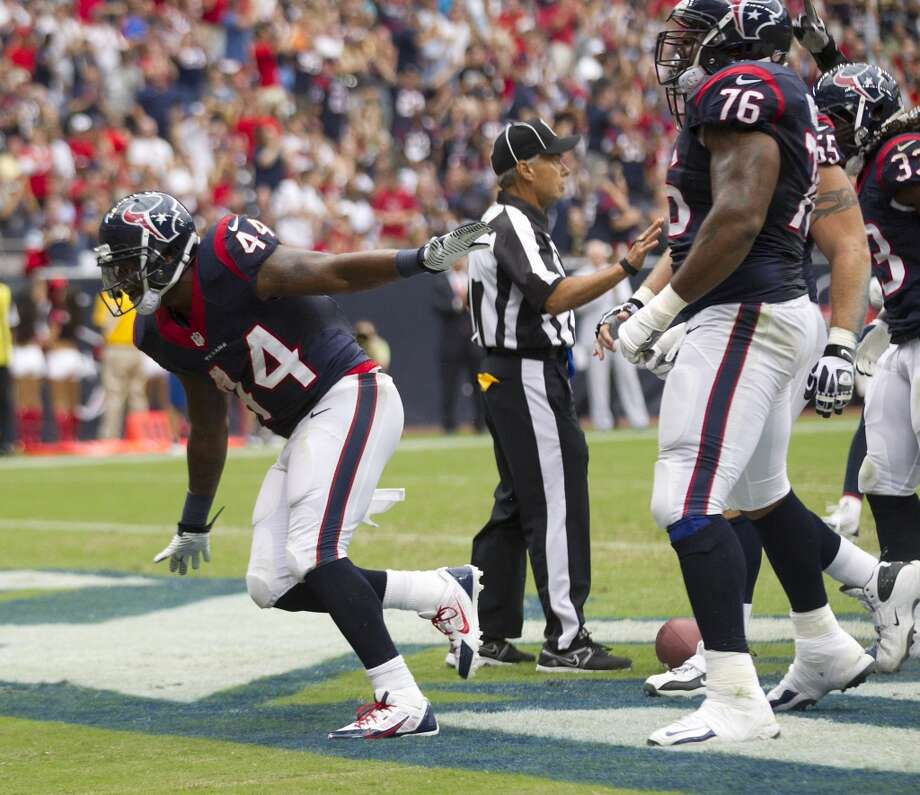 Texans running back Ben Tate celebrates a 1-yard touchdown run. Photo: Brett Coomer, Houston Chronicle