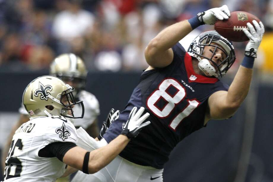 Texans tight end Owen Daniels dives for a reception with Saints free safety Jim Leonhard defending. Photo: Brett Coomer, Houston Chronicle