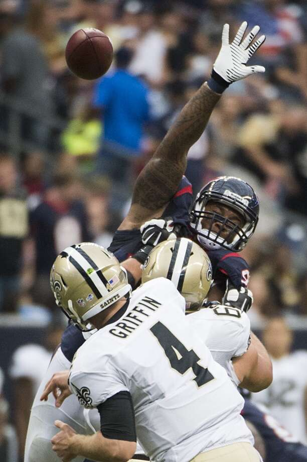 Texans defensive end Delano Johnson tries to knock down a pass by Saints quarterback Ryan Griffin. Photo: Smiley N. Pool, Houston Chronicle