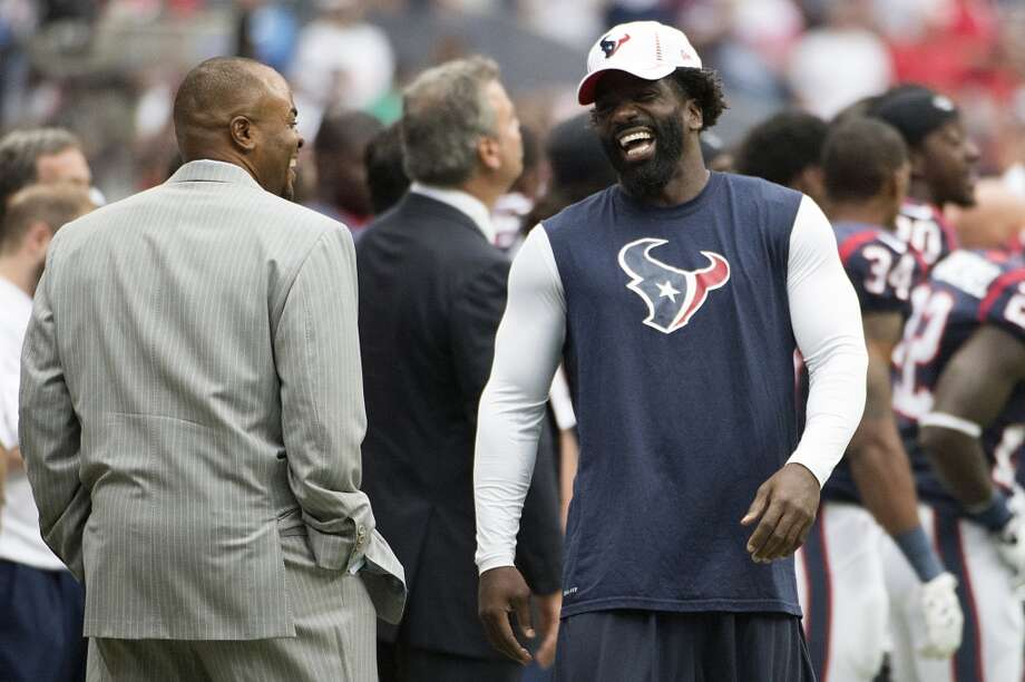 Texans free safety Ed Reed laughs with general manager Rick Smith before the game. Photo: Smiley N. Pool, Houston Chronicle