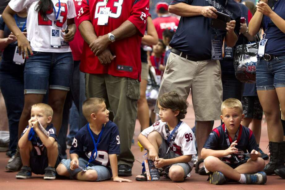 Texans fans watch warm-ups before a pre-season football game against the New Orleans Saints. Photo: Brett Coomer, Houston Chronicle