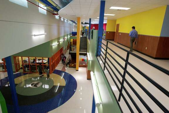 Parents and students walk through the colorful hallways of the newly constructed Atherton Elementary School in the Fifth Ward, a $15.8 million project.