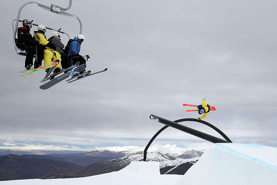 Rail grab:Chairlift riders watch Aussie Russell Henshaw perform a trick in the FIS Freestyle Ski   Slopestyle World Cup Finals at the Winter Games NZ at Cardrona resort, New   Zealand. Photo: Hannah Johnston, Getty Images