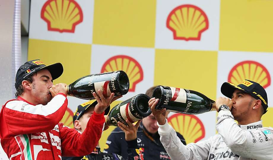 After the Grand Prix, a grand burp: Belgian Grand Prix winner Sebastian Vettel (Germany/Infiniti - center), runner-up Fernando Alonso (Spain/Ferrari - left)  and third-place finisher Lewis 