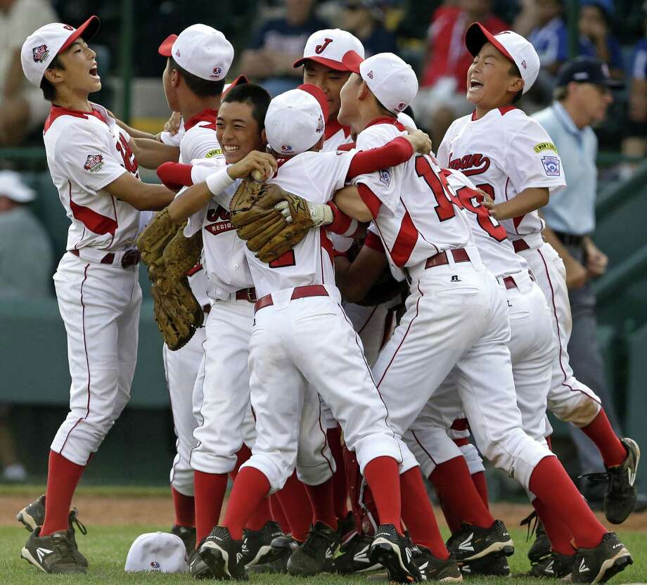 The team from Tokyo, Japan, shows its delight after a 6-4 comeback victory over Chula Vista, Calif., for the Little League World Series championship. It's Japan's third title in four years. Photo: Gene J. Puskar / Associated Press