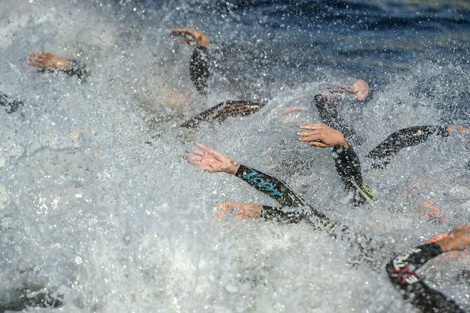 Swimmers roil the wateras the ITU World Triathlon elite race starts with a splash in Stockholm. Photo: Janerik Henriksson, Associated Press