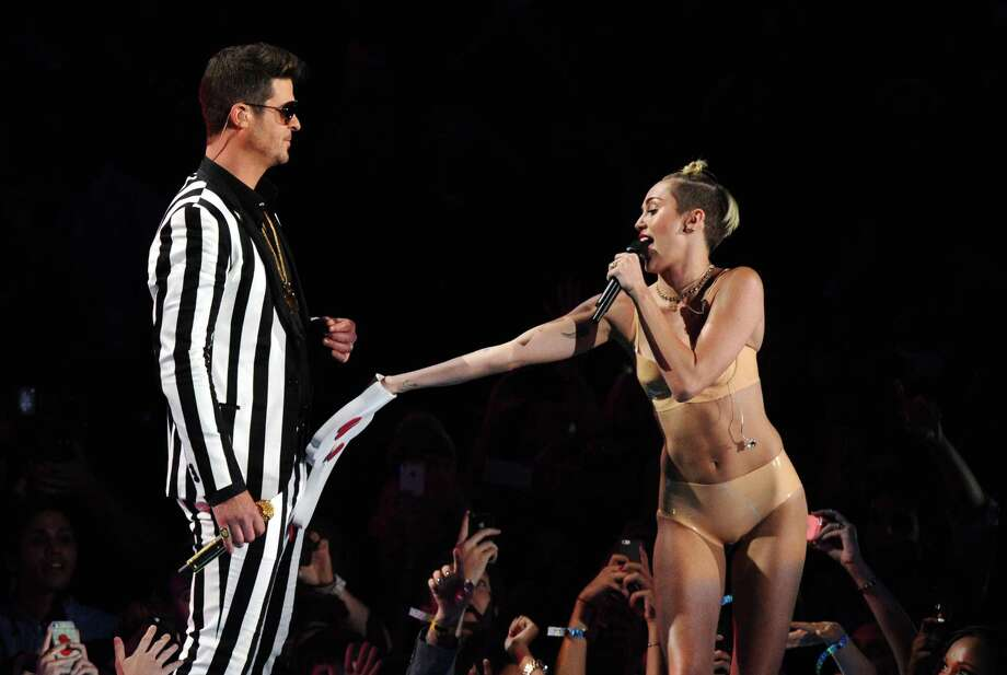"Robin Thicke, left, and Miley Cyrus perform ""Blurred Lines"" at the MTV Video Music Awards on Sunday, Aug. 25, 2013, at the Barclays Center in the Brooklyn borough of New York. Photo: AP"
