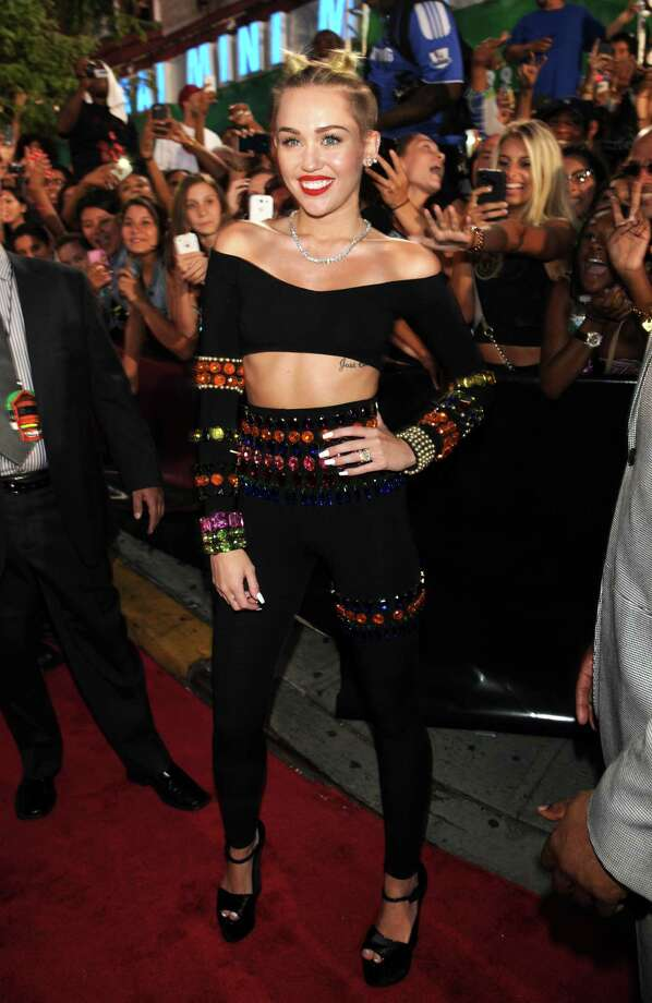 Miley Cyrus arrives at the MTV Video Music Awards on Sunday, Aug. 25, 2013, at the Barclays Center in the Brooklyn borough of New York. Photo: AP