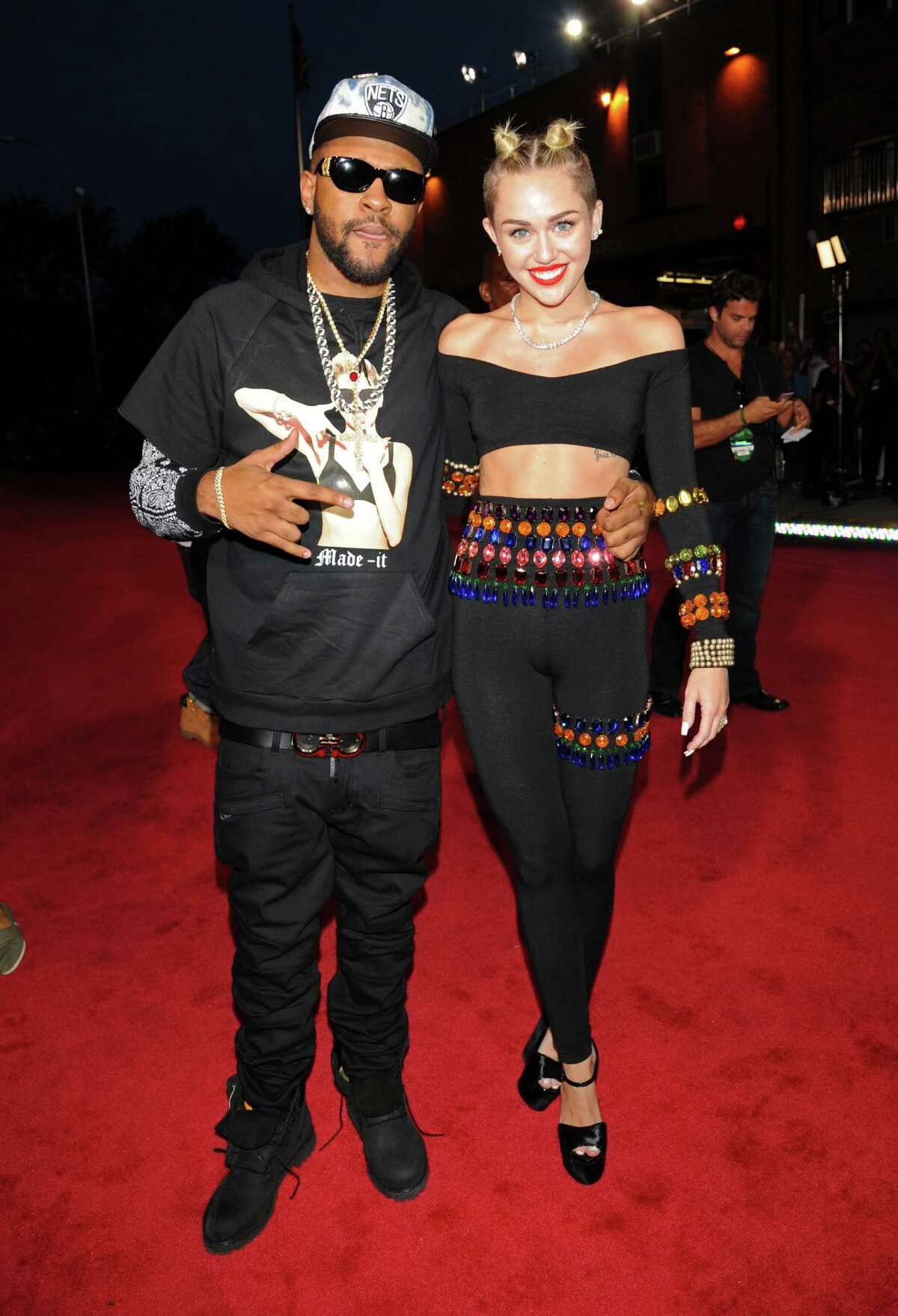 Mike Will Made It and Miley Cyrus, right, pose at the MTV Video Music Awards on Sunday, Aug. 25, 2013, at the Barclays Center in the Brooklyn borough of New York.