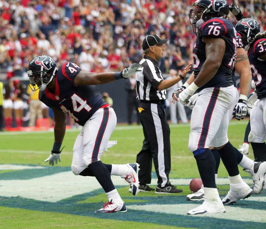 Texans running back Ben Tate, left, was ready for takeoff after his 1-yard touchdown in the first quarter. Tate rushed for 74 yards. Photo: Brett Coomer, Staff / © 2013  Houston Chronicle