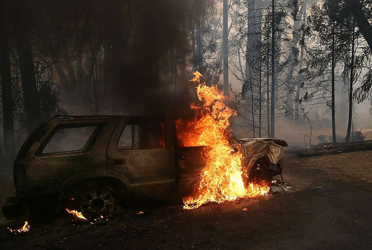 GROVELAND, CA - AUGUST 25: Flames billow from the front of a car that was consumed by the Rim Fire on August 25, 2013 near Groveland, California. The Rim Fire continues to burn out of control and threatens 4,500 homes outside of Yosemite National Park. Over 2,000 firefighters are battling the blaze that has entered a section of Yosemite National Park and is currently 7 percent contained. (Photo by Justin Sullivan/Getty Images)