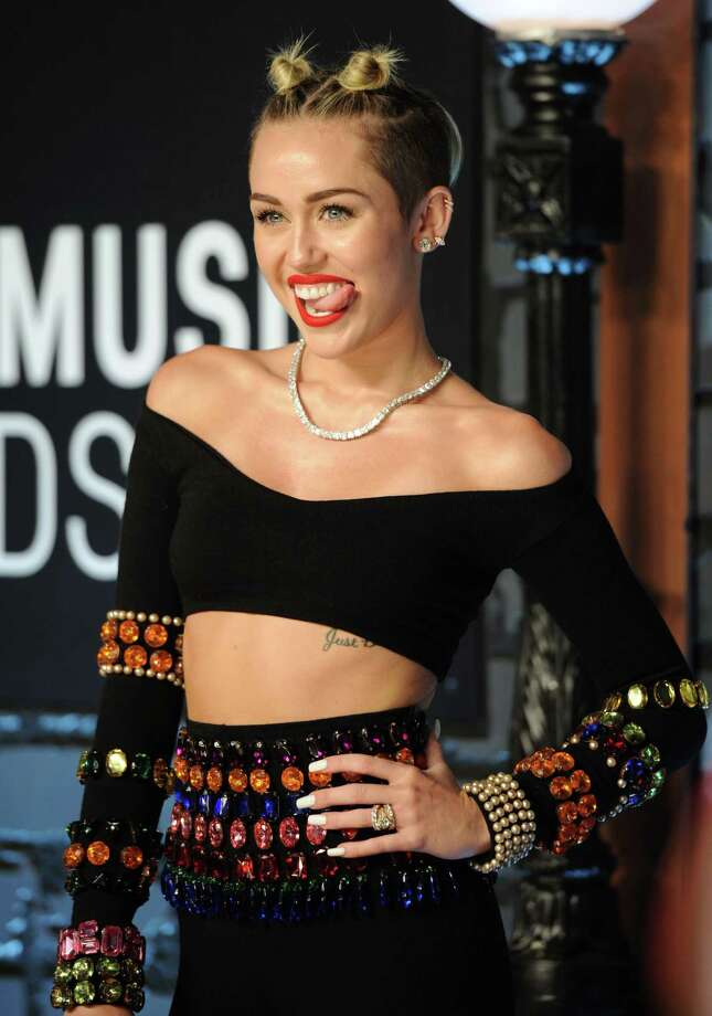 The world got more familiar than it wanted to with Miley Cyrus' tongue at the MTV Video Music Awards Photo: Evan Agostini, INVL / Invision