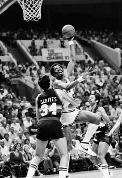 1983 Western Conference semifinals, Game 3 at Denver Nuggets: The Nuggets' Kiki Vandeweghe misses a jumper, sending the game into overtime, where the Spurs' Johnny Moore makes a 3-pointer with 12 seconds left to snag a 127-126 win. The Spurs win the series 4-1, but fall in the conference finals to the Los Angeles Lakers 4-2.  PHOTO: The Spurs' Artis Gilmore puts a hook shot over the head of the Nuggets' Danny Schayes during Game 5 on May 4, 1983, in San Antonio. (David Breslauer / Associated Press) Photo: David Breslauer, Associated Press