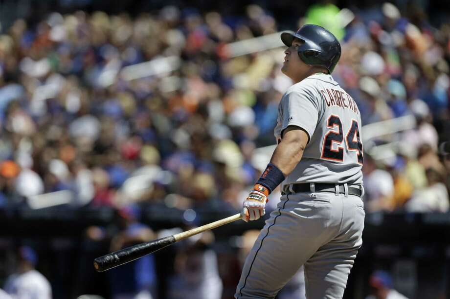 The Tigers' Miguel Cabrera admires his work, a two-run homer that traveled an estimated 429 feet. Photo: Seth Wenig, STF / AP