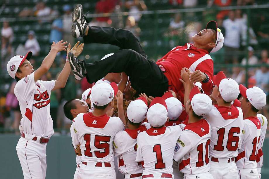 Manager Masumi Omae goes for a joy ride after Japan won the Little League title. Photo: Rob Carr, Staff / 2013 Getty Images
