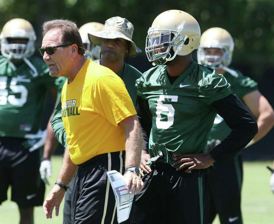 Coordinator Phil Bennett (left) and safety Ahmad Dixon were part of a defense that was one of the worst in the nation in 2012. Photo: Rod Aydelotte / Waco Tribune-Herald