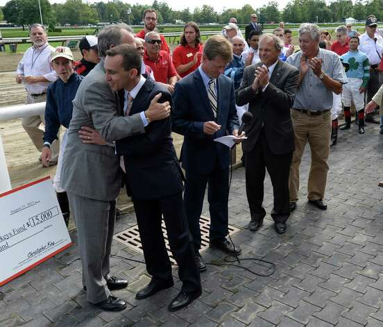 NYRA president Chris Kay gives retired  jockey Ramon Dominguez a hug at the ceremony where Dominguez received his Eclipse and Venezia Awards Aug 25, 2013, at the Saratoga Race Course in Saratoga Springs, N.Y.  (Skip Dickstein/Times Union) Photo: SKIP DICKSTEIN