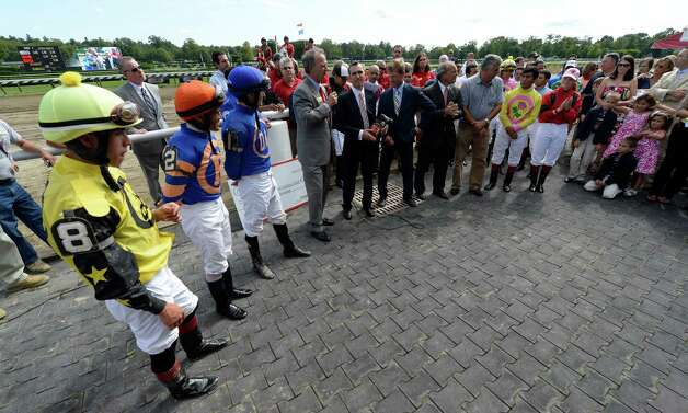 NYRA president Chris Kay, center announces the awards for retired  jockey Ramon Dominguez Aug 25, 2013, at the Saratoga Race Course in Saratoga Springs, N.Y. Eclipse and Venezia Awards were presented to Dominguez during the ceremony.   (Skip Dickstein/Times Union) Photo: SKIP DICKSTEIN