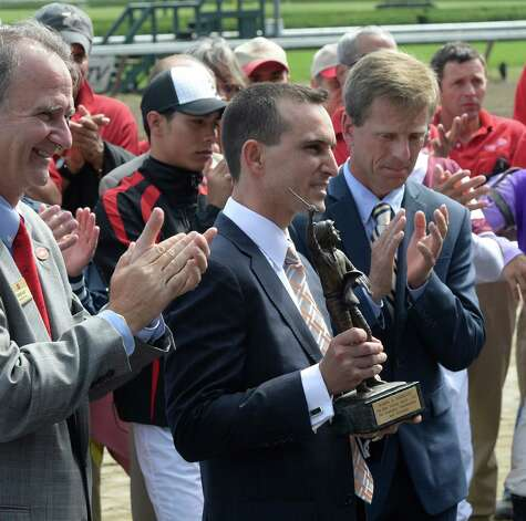 Retired  jockey Ramon Dominguez receives the Venezia Award for the top jockey in 2012  Aug 25, 2013, at the Saratoga Race Course in Saratoga Springs, N.Y. Dominguez was presented an Eclipse and Venezia Awards during the ceremony in the winner's circle.  (Skip Dickstein/Times Union) Photo: SKIP DICKSTEIN