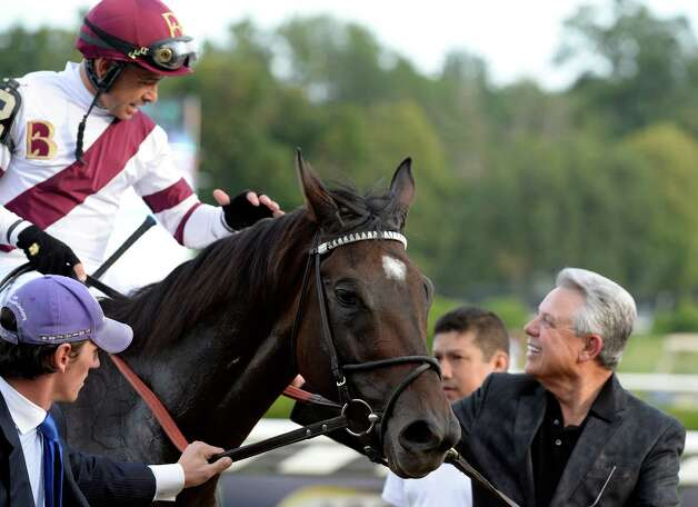 Jockey Mike Smith is all smiles aboard Royal Delta as he is greeted by owner Ben Leon, right after winning the 66th running of The Personal Ensign Invitational Aug 25, 2013, at the Saratoga Race Course in Saratoga Springs, N.Y.   (Skip Dickstein/Times Union) Photo: SKIP DICKSTEIN