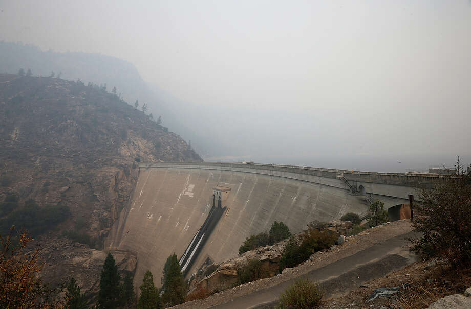 Smoke from the Rim Fire lingers over the O'Shaughnessy Dam at Hetch Hetchy Reservoir in Yosemite National Park, the source of San Francisco's water. Photo: Justin Sullivan / Getty Images / 2013 Getty Images