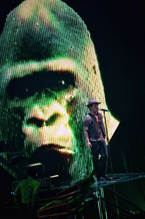 Bruno Mars and his gorilla perform. Photo: Rick Diamond, Getty Images For MTV
