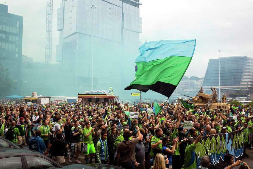 A massive crowd makes its way toward CenturyLink Field during a Seattle Sounders rally before the Cascadia Cup match against the Portland Timbers Sunday, August 25, 2013, in Seattle. The sold-out match marked Clint Dempsey's first home game as a member of the Seattle Sounders FC.