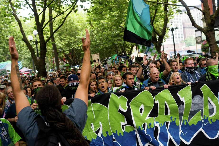 Superfans gather at a Seattle Sounders rally before the Cascadia Cup match against the Portland Timbers Sunday, August 25, 2013, at CenturyLink Field in Seattle. The sold-out match marked Clint Dempsey's first home game as a member of the Seattle Sounders FC. Photo: JORDAN STEAD, SEATTLEPI.COM / SEATTLEPI.COM