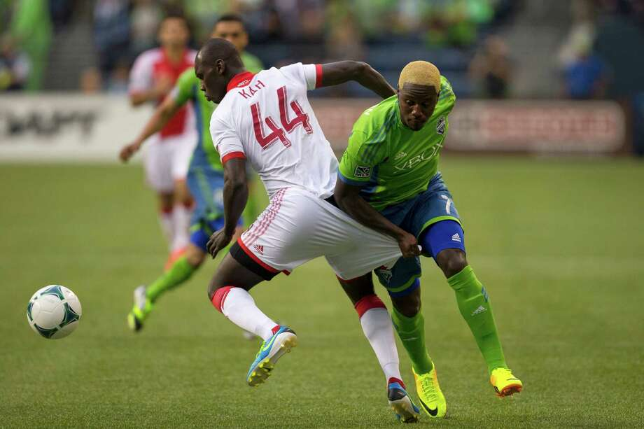 Eddie Johnson, right, pulls down the pants of Pa Modou Kah, left, during the first half of the Cascadia Cup match Sunday, August 25, 2013, at CenturyLink Field in Seattle. The sold-out match marked Clint Dempsey's first home game as a member of the Seattle Sounders FC. Photo: JORDAN STEAD, SEATTLEPI.COM / SEATTLEPI.COM