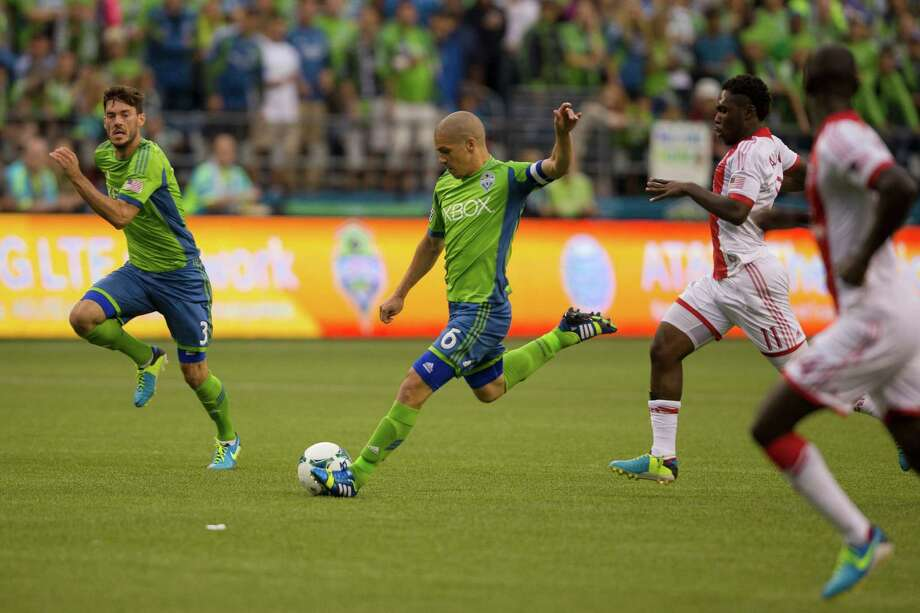 Osvaldo Alonso, center, dribbles downfield during the first half of the Cascadia Cup match Sunday, August 25, 2013, at CenturyLink Field in Seattle. The sold-out match marked Clint Dempsey's first home game as a member of the Seattle Sounders FC. Photo: JORDAN STEAD, SEATTLEPI.COM / SEATTLEPI.COM