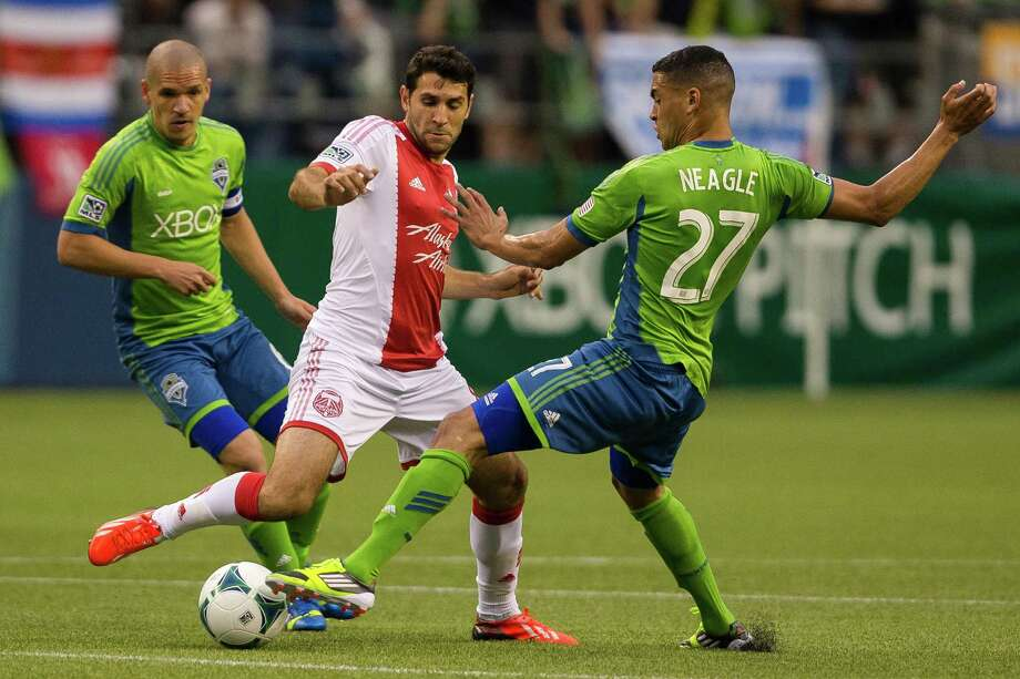 Lamar Neagle, right, blocks Timber offense during the first half of the Cascadia Cup match Sunday, August 25, 2013, at CenturyLink Field in Seattle. The sold-out match marked Clint Dempsey's first home game as a member of the Seattle Sounders FC. Photo: JORDAN STEAD, SEATTLEPI.COM / SEATTLEPI.COM