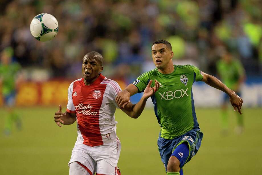 Sounders and Timbers compete for ball control during the first half of the Cascadia Cup match Sunday, August 25, 2013, at CenturyLink Field in Seattle. The sold-out match marked Clint Dempsey's first home game as a member of the Seattle Sounders FC. Photo: JORDAN STEAD, SEATTLEPI.COM / SEATTLEPI.COM