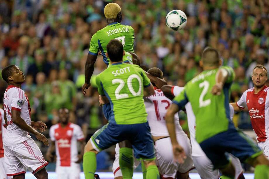 Eddie Johnson, center, makes the one and only goal of the game off a header during the second half of the Cascadia Cup match Sunday, August 25, 2013, at CenturyLink Field in Seattle. The Sounders beat the Timbers 1-0. The sold-out match marked Clint Dempsey's first home game as a member of the Seattle Sounders FC. Photo: JORDAN STEAD, SEATTLEPI.COM / SEATTLEPI.COM